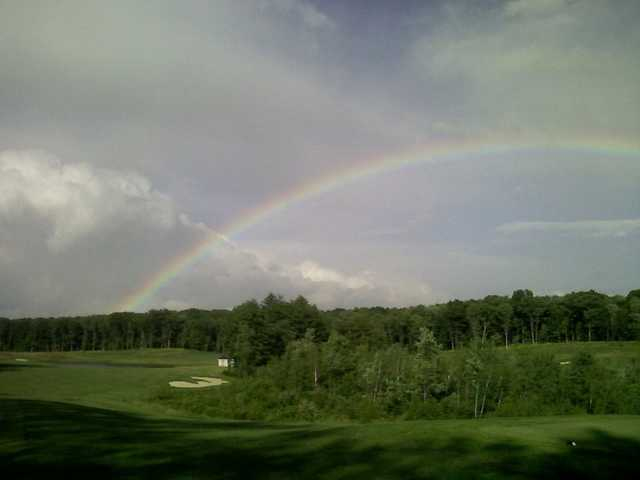 A view of the rainbow over hole #6 at Ridge Course from Blue Ridge Trail Golf Club.