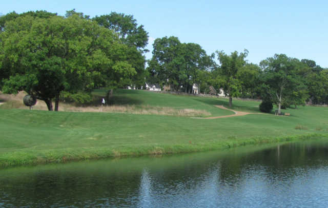 A view over the water of green at Belle Meade Country Club