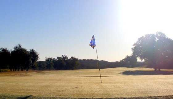 A sunny view of a hole at Lone Cedar Country Club
