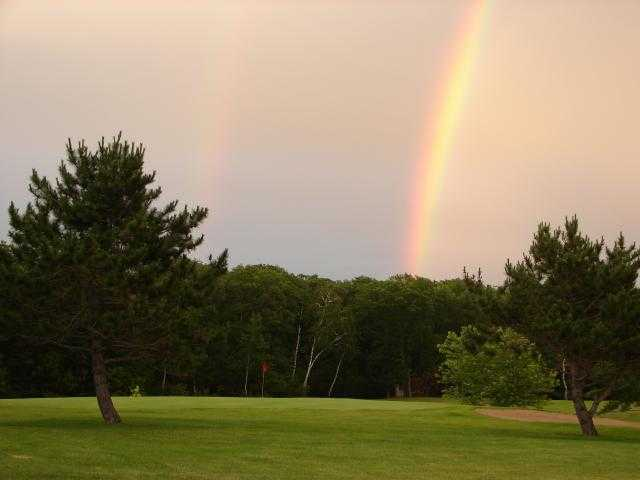 A view of rainbow over the 7th hole at Afton Alps Golf Course
