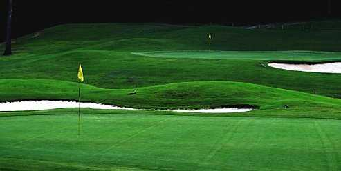 A view of greens guarded by sand traps at Northridge Country Club