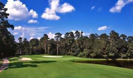A view of a hole surrounded by bunkers at Oaks Course from The Golf Trails of The Woodlands