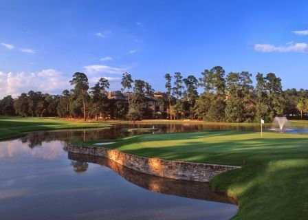 A view of a green surrounded by water at Panther Trail Course from The Golf Trails of The Woodlands