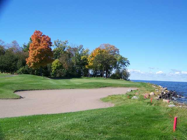 A fall view of green #14 at Black Brook Course from Izatys Golf & Yacht Club.