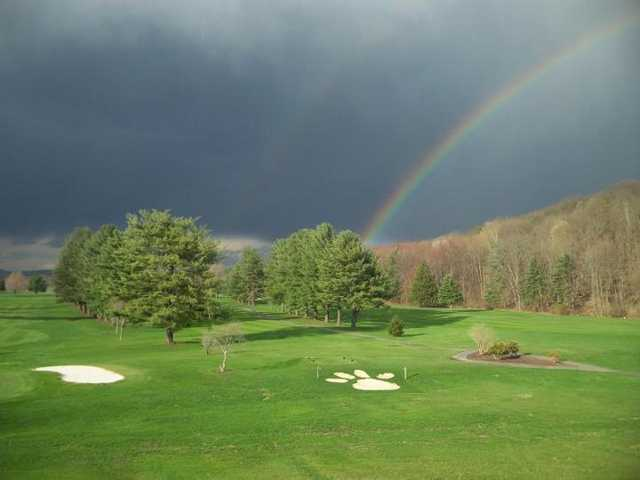 A view of a rainbow over The Lynx at River Bend Golf Club