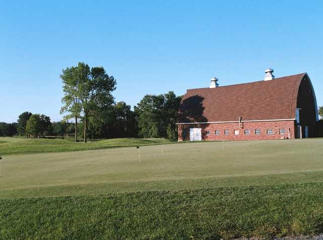 A view of the clubhouse and putting green at Tanners Brook Golf Club
