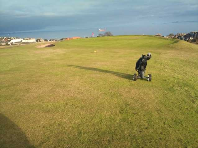 A view of a hole with sand trap on the left side at Scoonie Golf Club