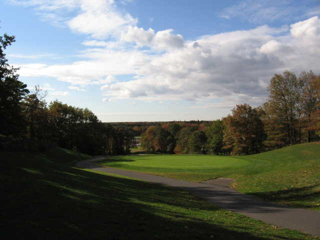 View of the 17th green with narrow path on the left at Cedar Creek Golf Course