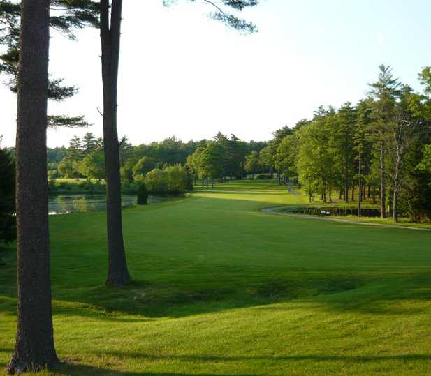A sunny view of fairway with water on sides at Pembroke Country Club