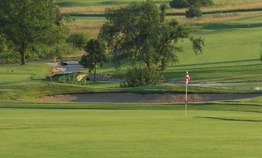 A view of a green protected by bunker at Redfield Golf & Country Club