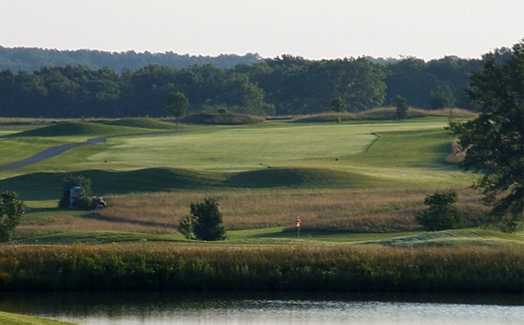 A view over the water of a hole and a fairway at Redfield Golf & Country Club