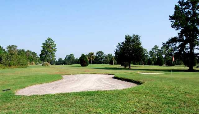 A view of a hole guarded by bunker at Folkston Golf Club