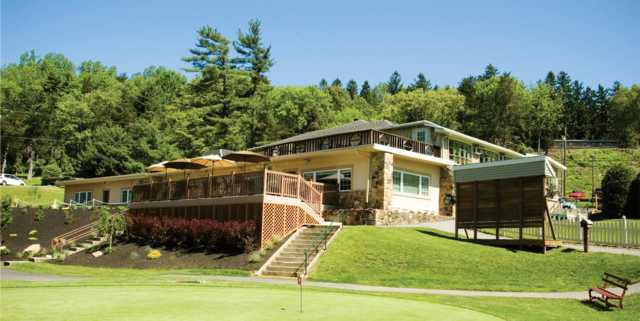 A view of the clubhouse and putting green at Galen Hall Golf Club