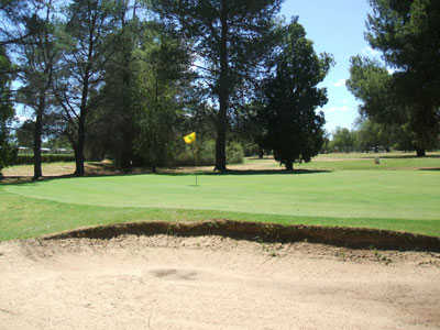 A view of green protected by sand trap at Berrigan Golf & Bowling Club