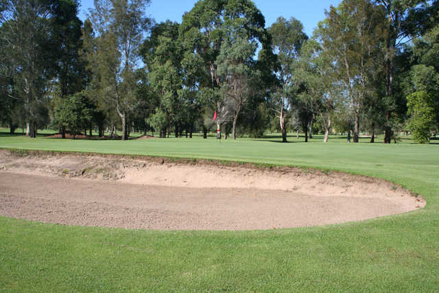 A view of the 3rd green guarded by bunker at Moruya Golf Club