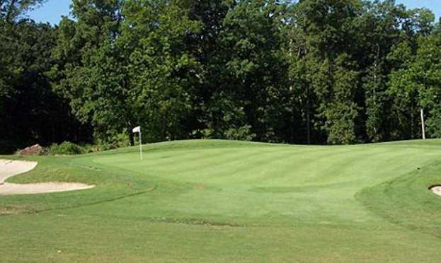 A view of green #1 protected by bunkers at West Course from South Hills Golf Club