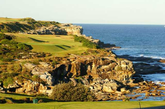 A view of the 14th hole high above Little Bay at Coast Golf & Recreation Club