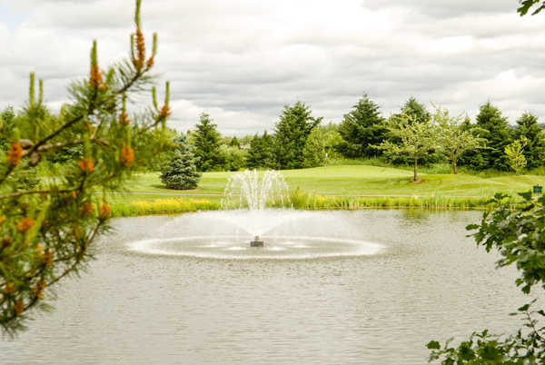 A view over the water of a hole at Heron Links Course from Willows Run Golf Club