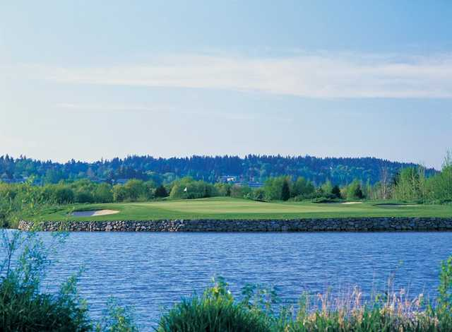 A view over the water of a green at Eagle's Talon Course from Willows Run Golf Club