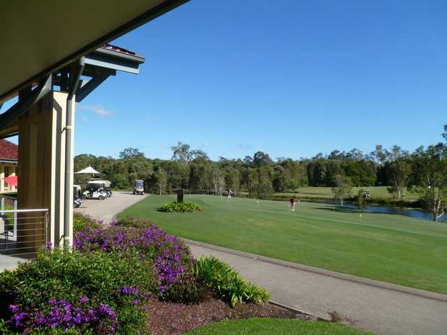 A view from the clubhouse of the practice putting green at Pelican Waters Golf Club