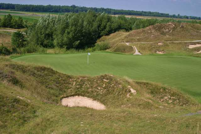 """The par-3 13th hole on the Irish Course at Whistling Straits is a great """"Dell Hole"""" featuring a blind tee shot to a hidden green."""