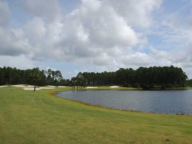 The fifth hole at The Club at Venetian Bay is reachable in two, but it plays around a lake.