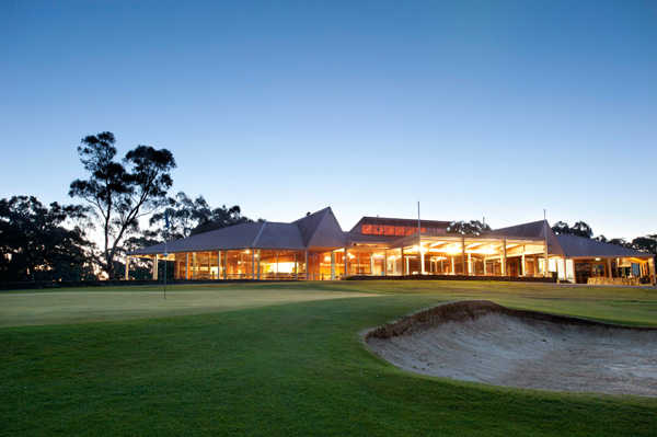A view of a green protected by bunkers with wedding area in background at Aston Hills Golf Club at Mount Barker