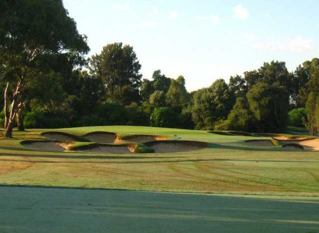 A view of a green protected by bunkers at Grange Golf Club