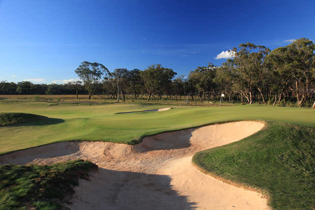 A view of green guarded by bunkers at Eynesbury Golf Course