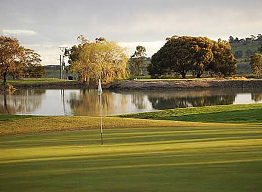 A view of the 16th green with water in background at Goonawarra Golf Club