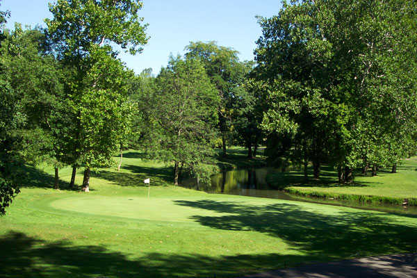 A sunny view of green with water coming into play at Kings Mill Golf Club