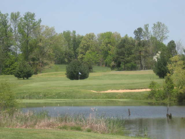 A view over the pond of the 16th green at Southern Hills Golf & Country Club