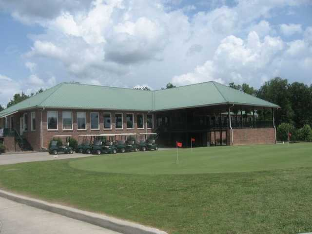 A view of the clubhouse and putting green at Southern Hills Golf & Country Club