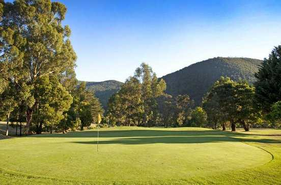 A view of the 6th green bathed in sunshine at Warburton Golf Club