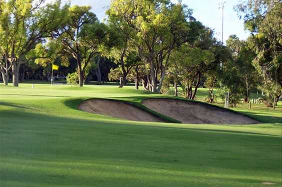 A view of hole #3 guarded by bunkers at Nedlands Golf Club
