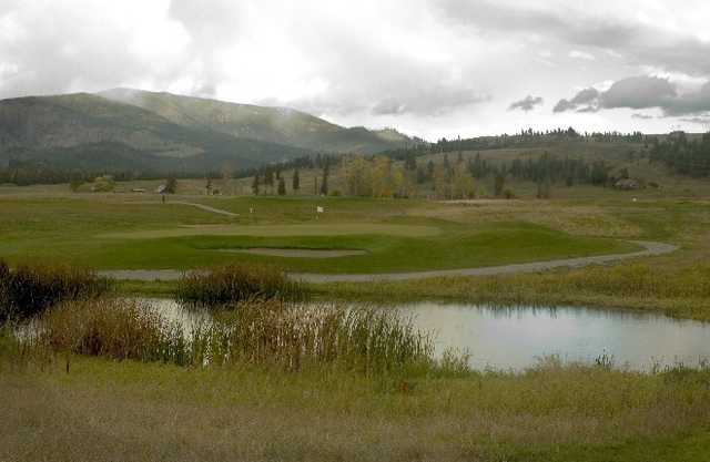 A view over the pond of the 16th green at Dominion Meadows Golf Course