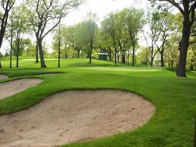 A view of the 11th green protected by sand traps at Blackhawk Country Club