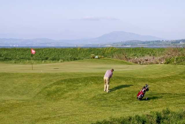 A view of a hole with mountains in background at Letterkenny Golf Club