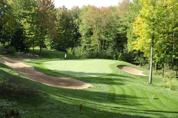 A view of a hole protected by bunkers at Pine Valley Golf Course