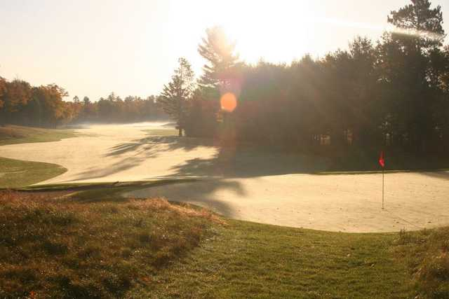 A sunny view of a green at Minocqua Country Club