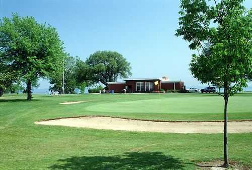 A view of the clubhouse with green in foreground at Shoop Park Golf Course