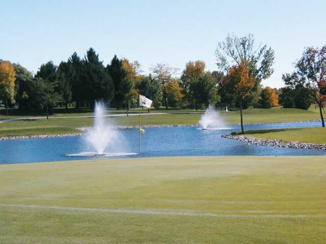 A view of the 7th green with water coming into plat at Berms from Sheboygan Town & Country Golf Club