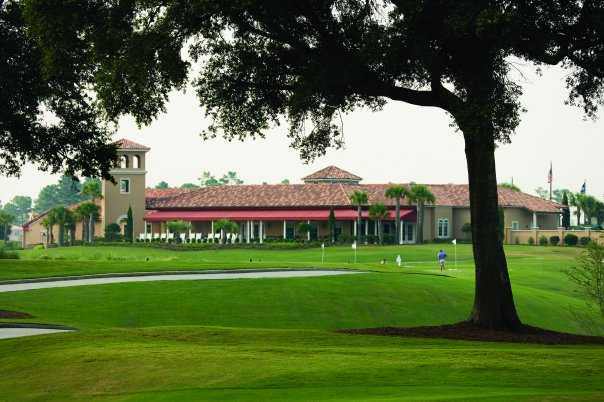 A view of the clubhouse and practice area at Grande Dunes Resort Club