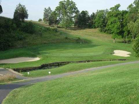 A view of green #7 guarded by bunkers at Creek Course from Shenvalee Golf Club