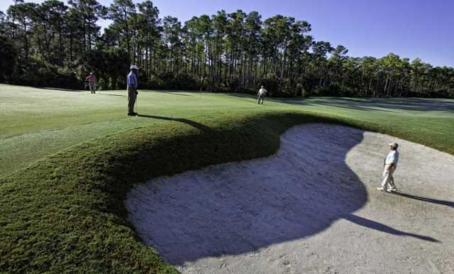 A view of green guarded by bunker from The Club At Mediterra
