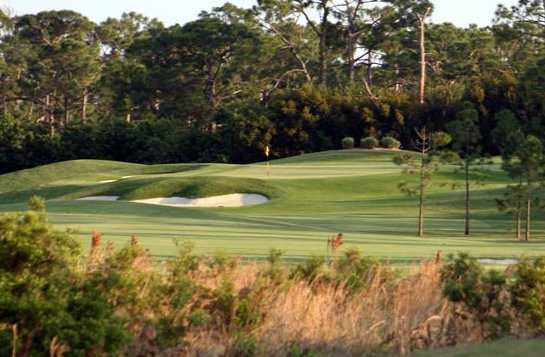 A view of a green protected by bunkers at The Fox Club.
