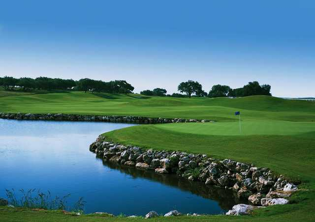 A view of a green surrounded by water at Lakecliff Country Club