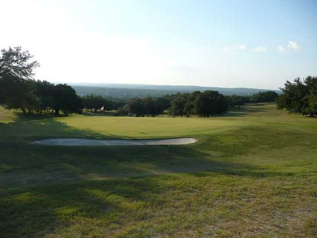 A view of green protected by sand trap at Pedernales Country Club