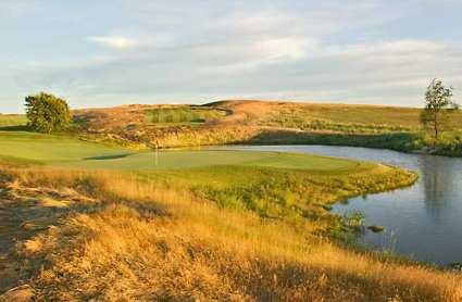 A view of a green surrounded by water from The Legend At Bergamont.