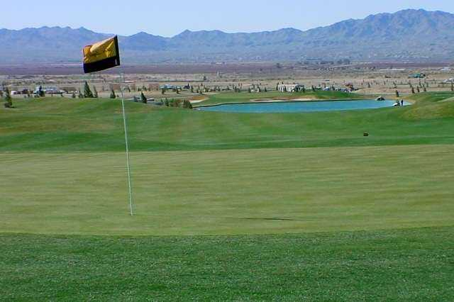 A view of the 17th green with a pond in background at Los Lagos Golf Club.